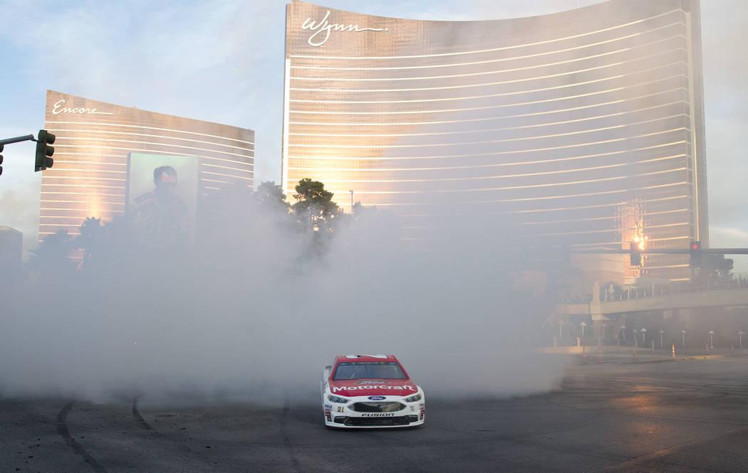 Race car driver Ryan Blaney (21) burns out on the Vegas Strip during Nascarճ Victory Lap on Wednesday, Nov. 29, 2017.  Richard Brian Las Vegas Review-Journal @vegasphotograph