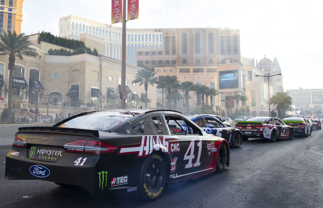 Race car driver Kurt Busch (41) and other drivers take a lap on the Vegas Strip during Nascarճ Victory Lap on Wednesday, Nov. 29, 2017.  Richard Brian Las Vegas Review-Journal @vegasphotograph