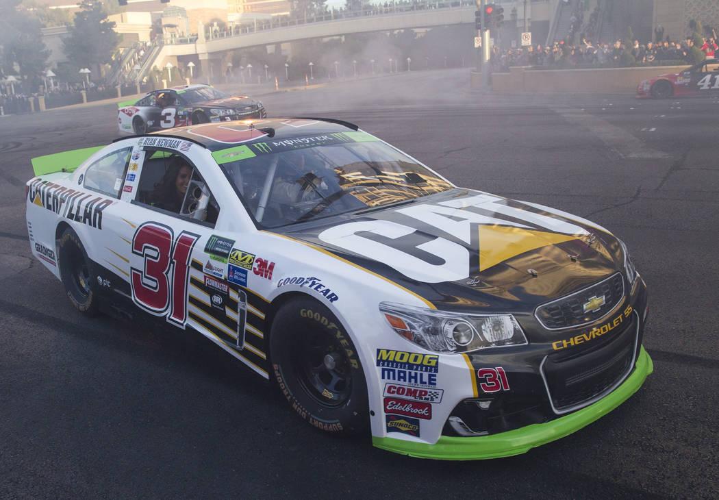 Race car drivers Ryan Newman (31) and Austin Dillon (3) take a lap on the Vegas Strip during Nascarճ Victory Lap on Wednesday, Nov. 29, 2017.  Richard Brian Las Vegas Review-Journal @vegasph ...