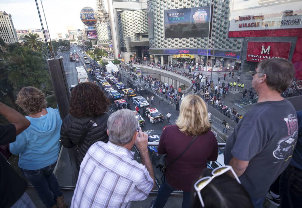 Race car fans wait for the start of Nascarճ Victory Lap on the Vegas Strip on Wednesday, Nov. 29, 2017.  Richard Brian Las Vegas Review-Journal @vegasphotograph