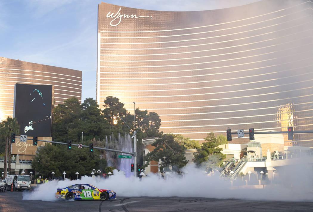 Race car driver Kyle Busch (21) burns out on the Vegas Strip during Nascarճ Victory Lap on Wednesday, Nov. 29, 2017.  Richard Brian Las Vegas Review-Journal @vegasphotograph
