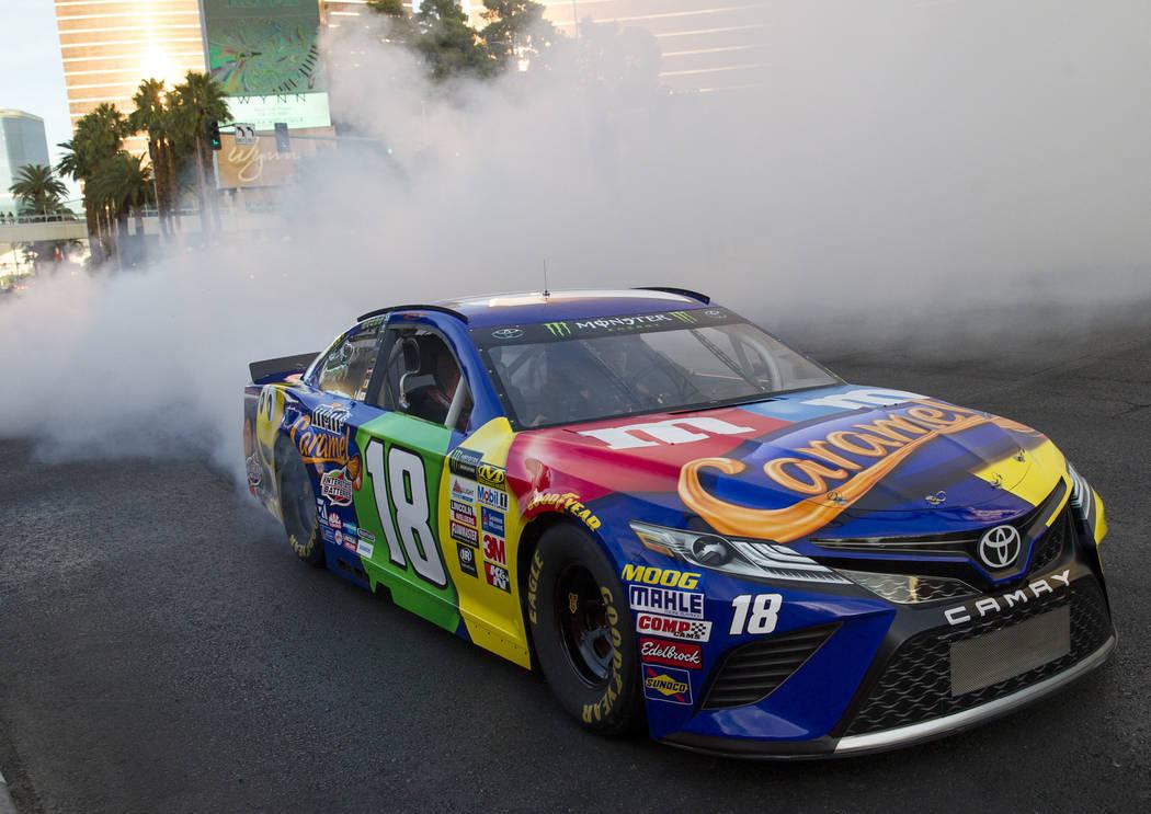 Race car driver Kyle Busch (18) burns out on the Vegas Strip during Nascarճ Victory Lap on Wednesday, Nov. 29, 2017.  Richard Brian Las Vegas Review-Journal @vegasphotograph