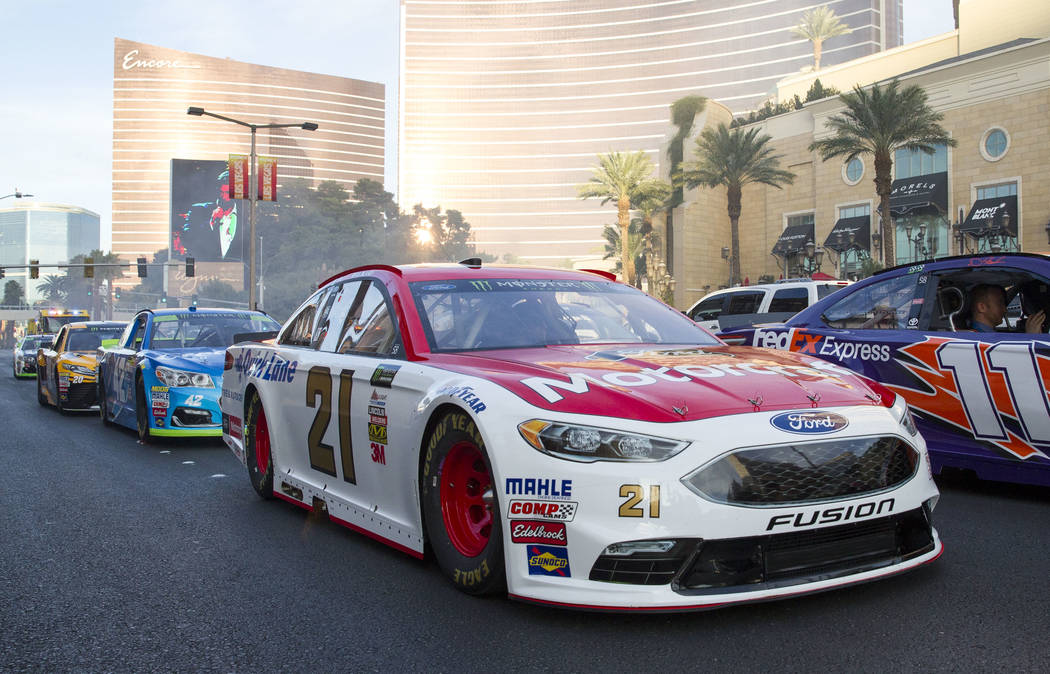 Race car driver Ryan Blaney (21) and other drivers take a lap on the Vegas Strip during Nascarճ Victory Lap on Wednesday, Nov. 29, 2017.  Richard Brian Las Vegas Review-Journal @vegasphotograph