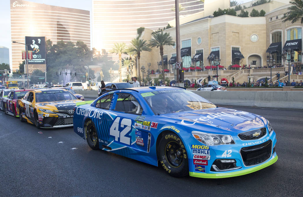 Race car driver Kyle Larson (42) and other drivers take a lap on the Vegas Strip during Nascarճ Victory Lap on Wednesday, Nov. 29, 2017.  Richard Brian Las Vegas Review-Journal @vegasphotograph