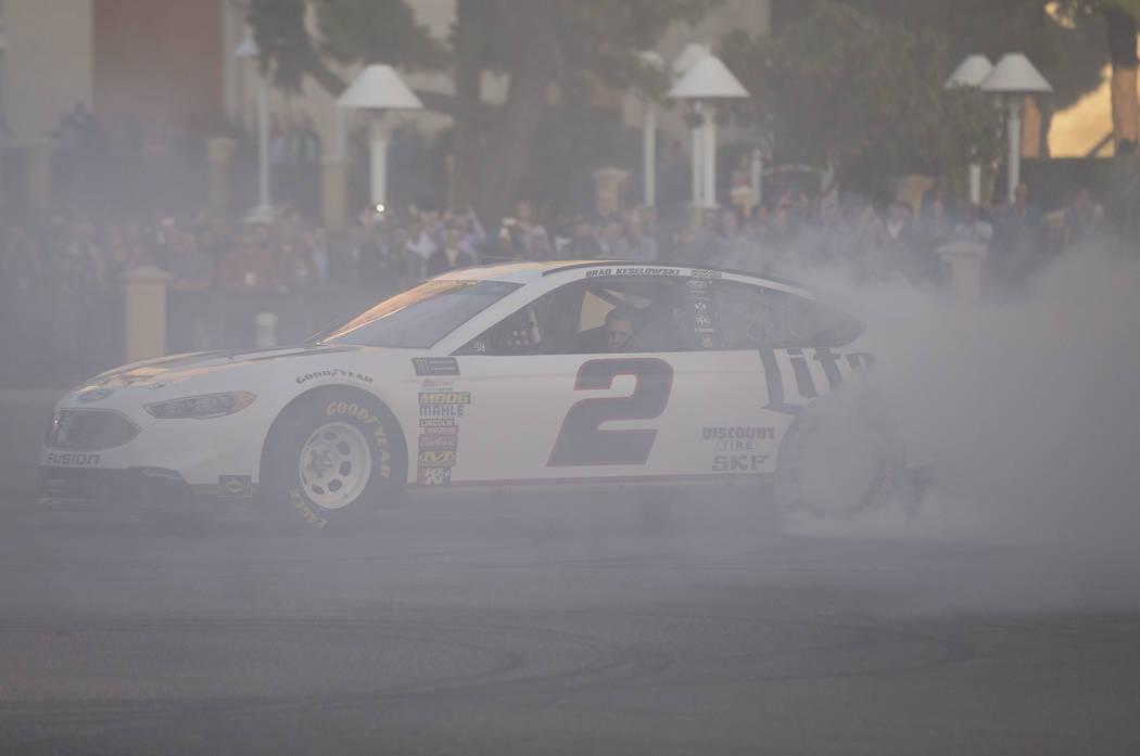 Race car driver Brad Keselowski (2) burns out on the Vegas Strip during Nascarճ Victory Lap on Wednesday, Nov. 29, 2017.  Richard Brian Las Vegas Review-Journal @vegasphotograph