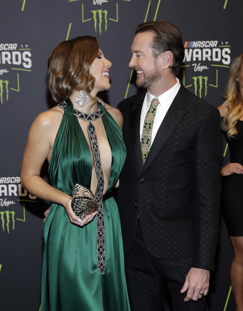 Kurt Busch and Ashley Busch arrive at the NASCAR Cup Series auto racing awards Thursday, Nov. 30, 2017, in Las Vegas. (AP Photo/Isaac Brekken)