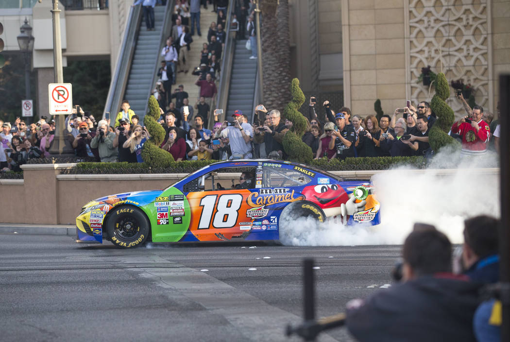 Race car driver Kyle Busch (18) burns out on the Vegas Strip during Nascarճ Victory Lap on Wednesday, Nov. 29, 2017.  Richard Brian Las Vegas Review-Journal @vegasphotograph