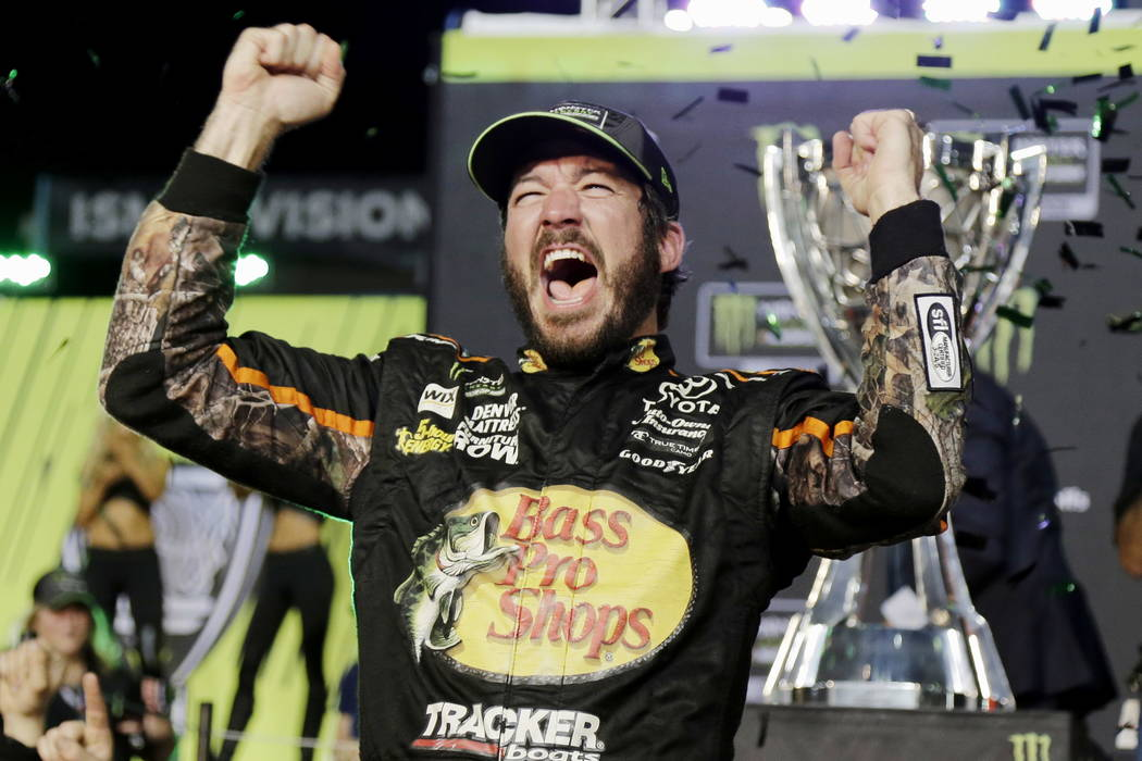 Martin Truex Jr. celebrates in Victory Lane after winning the NASCAR Cup Series auto race and season championship at Homestead-Miami Speedway in Homestead, Fla., Sunday, Nov. 19, 2017.  (AP Photo/ ...