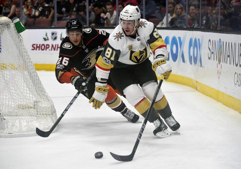 November 22, 2017; Anaheim, CA, USA; Vegas Golden Knights center Jonathan Marchessault (81) moves the puck ahead of Anaheim Ducks defenseman Brandon Montour (26) during the first period at Honda C ...