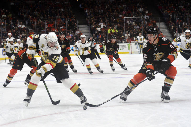 November 22, 2017; Anaheim, CA, USA; Vegas Golden Knights right wing Reilly Smith (19) moves the puck against the defense of Anaheim Ducks defenseman Josh Manson (42) during the first period at Ho ...