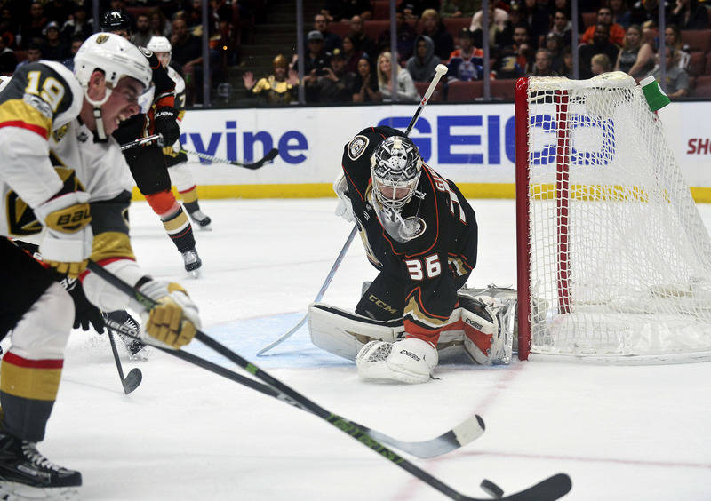 November 22, 2017; Anaheim, CA, USA; Anaheim Ducks defenseman Brandon Montour (26) defends the goal as Vegas Golden Knights right wing Reilly Smith (19) moves in for a shot during the first period ...