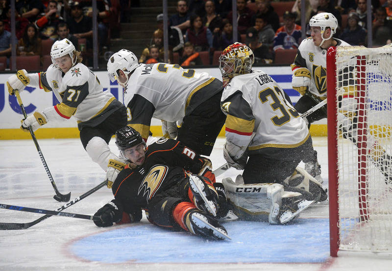 November 22, 2017; Anaheim, CA, USA; Vegas Golden Knights center William Karlsson (71) recovers the puck after goalie Maxime Lagace (33) defends the goal against Anaheim Ducks center Derek Grant ( ...
