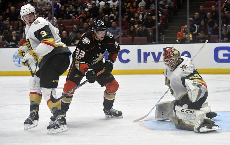 November 22, 2017; Anaheim, CA, USA; Anaheim Ducks right wing Jakob Silfverberg (33) moves in on goal against Vegas Golden Knights defenseman Brayden McNabb (3) and goalie Maxime Lagace (33) durin ...