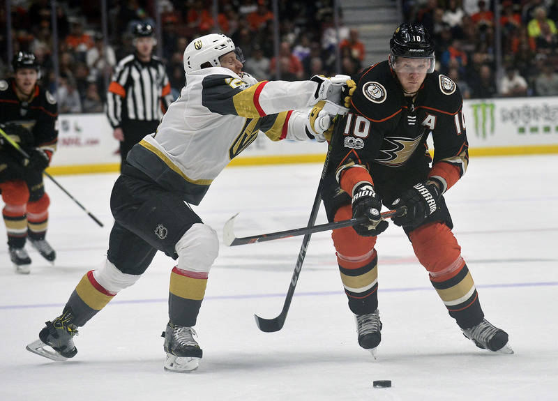 November 22, 2017; Anaheim, CA, USA; Anaheim Ducks right wing Corey Perry (10) moves the puck ahead of Vegas Golden Knights center Cody Eakin (21) during the second period at Honda Center. Mandato ...