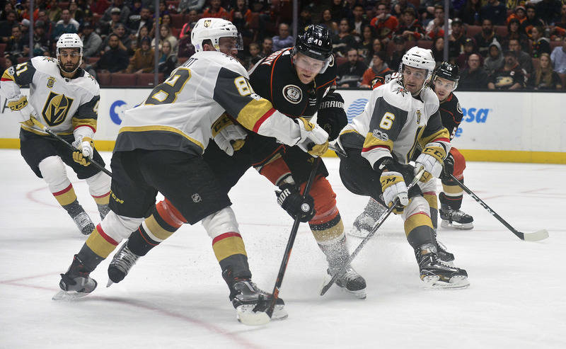 November 22, 2017; Anaheim, CA, USA; Anaheim Ducks right wing Corey Perry (10) is defended by Vegas Golden Knights defenseman Nate Schmidt (88) and defenseman Colin Miller (6) during the second pe ...