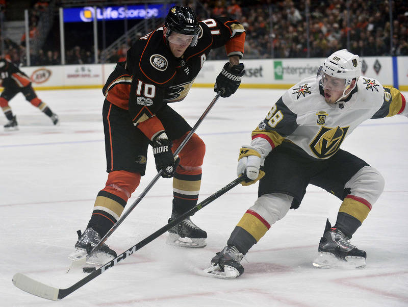 November 22, 2017; Anaheim, CA, USA; Anaheim Ducks right wing Corey Perry (10) moves the puck against the defense of Vegas Golden Knights defenseman Nate Schmidt (88) during the second period at H ...