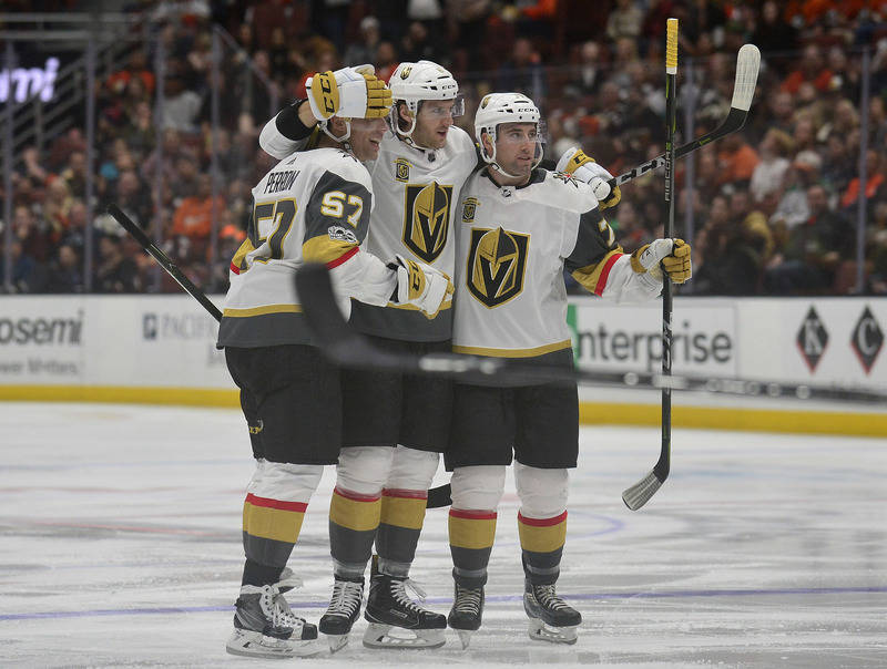 November 22, 2017; Anaheim, CA, USA; Vegas Golden Knights defenseman Colin Miller (6) celebrates with left wing David Perron (57) and defenseman Brad Hunt (77) his goal scored against the Anaheim  ...