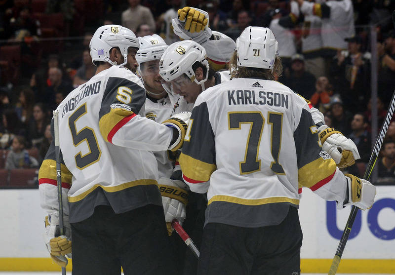 November 22, 2017; Anaheim, CA, USA; Vegas Golden Knights left wing James Neal (18) is congratulated by defenseman Deryk Engelland (5) and center William Karlsson (71) on his goal scored against t ...