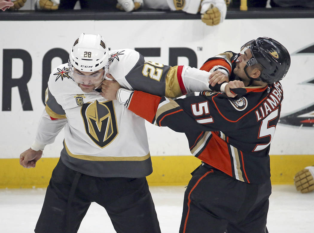 Vegas Golden Knights left winger William Carrier (28) and Anaheim Ducks left winger Mike Liambas (51) fight in the first period of an NHL hockey game in Anaheim, Calif., Wednesday, Nov. 22, 2017.  ...