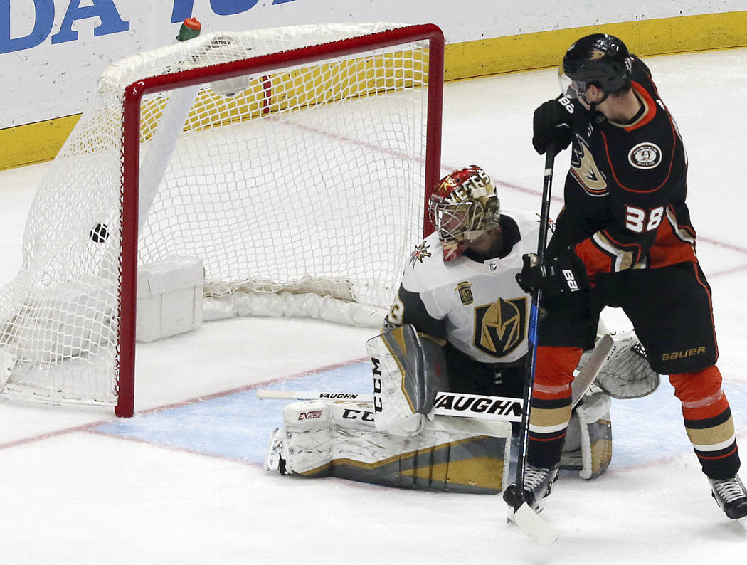 Anaheim Ducks center Derek Grant (38) gets the puck past Vegas Golden Knights goalie Maxime Legace (33) during the second period of an NHL hockey game in Anaheim, Calif., Wednesday, Nov. 22, 2017. ...