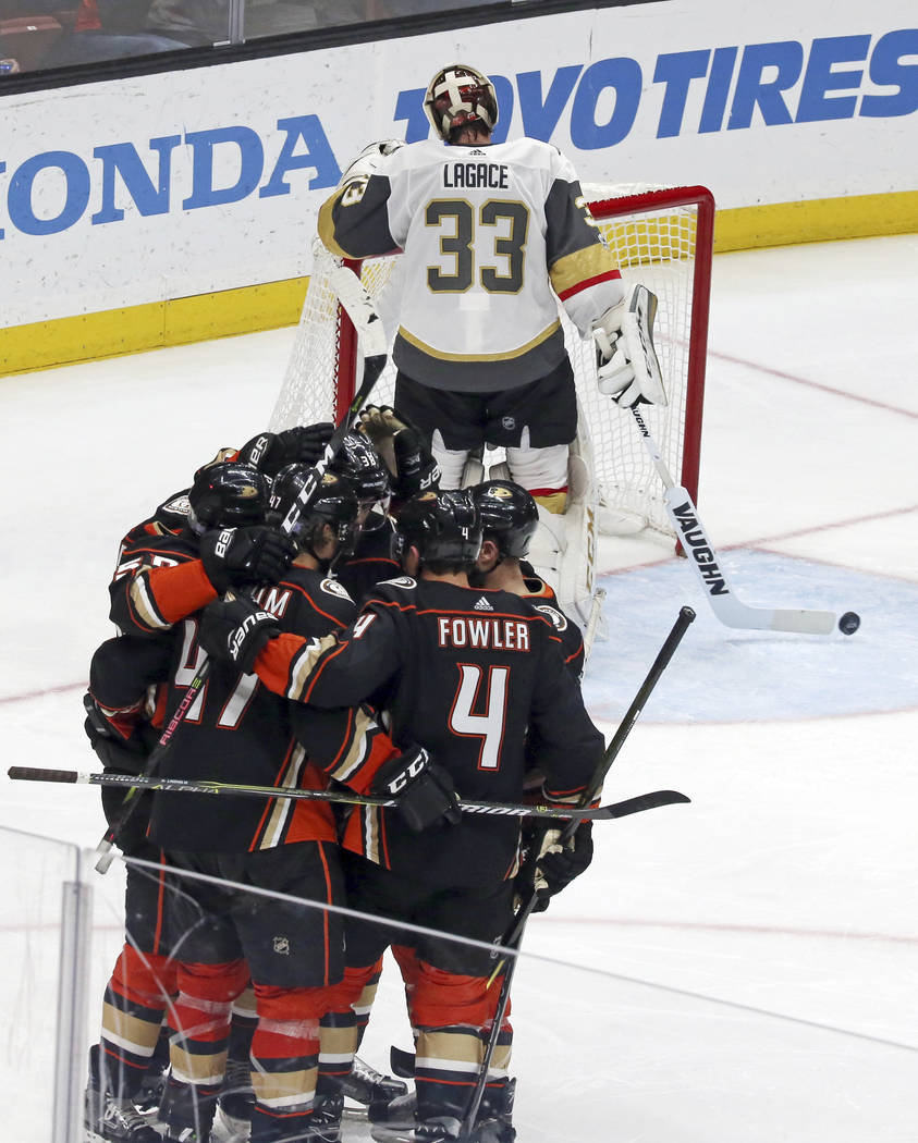 Vegas Golden Knights goalie Maxime Legace (33) clears the puck as Anaheim Ducks celebrate a goal during the second period of an NHL hockey game in Anaheim, Calif., Wednesday, Nov. 22, 2017. (AP Ph ...