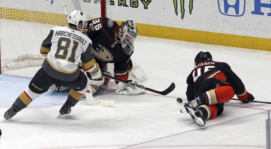 Vegas Golden Knights center Jonathan Marchessault (81) attacks as Anaheim Ducks goalie John Gibson (36) and defenseman Sami Vatanen (45) defend during the second period of an NHL hockey game in An ...