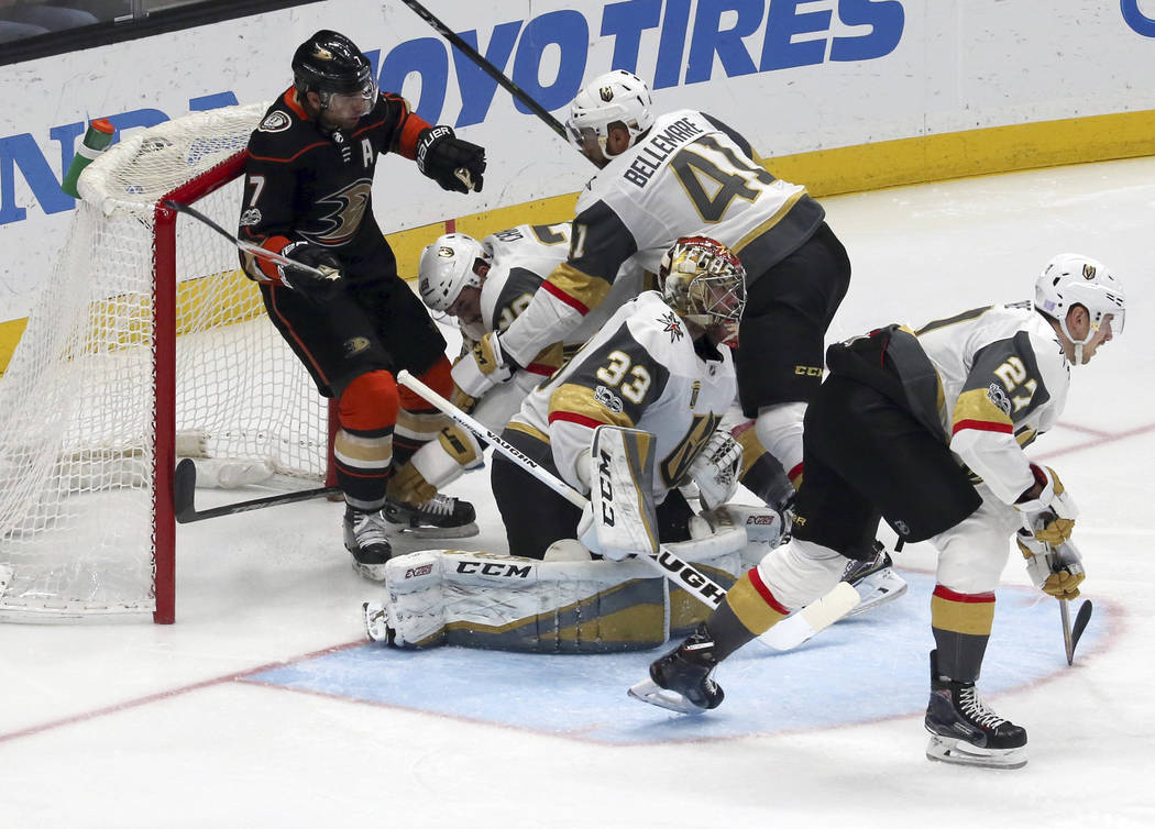Vegas Golden Knights and Anaheim Ducks pile up, knocking the goal out of place during the second period of an NHL hockey game in Anaheim, Calif., Wednesday, Nov. 22, 2017. (AP Photo/Reed Saxon)