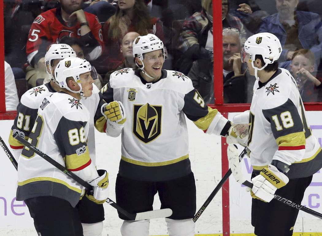 Vegas Golden Knights left wing Erik Haula (56) celebrates his goal with center Jonathan Marchessault (81) defenseman Nate Schmidt (88) and left wing James Neal (18) during the third period of an N ...