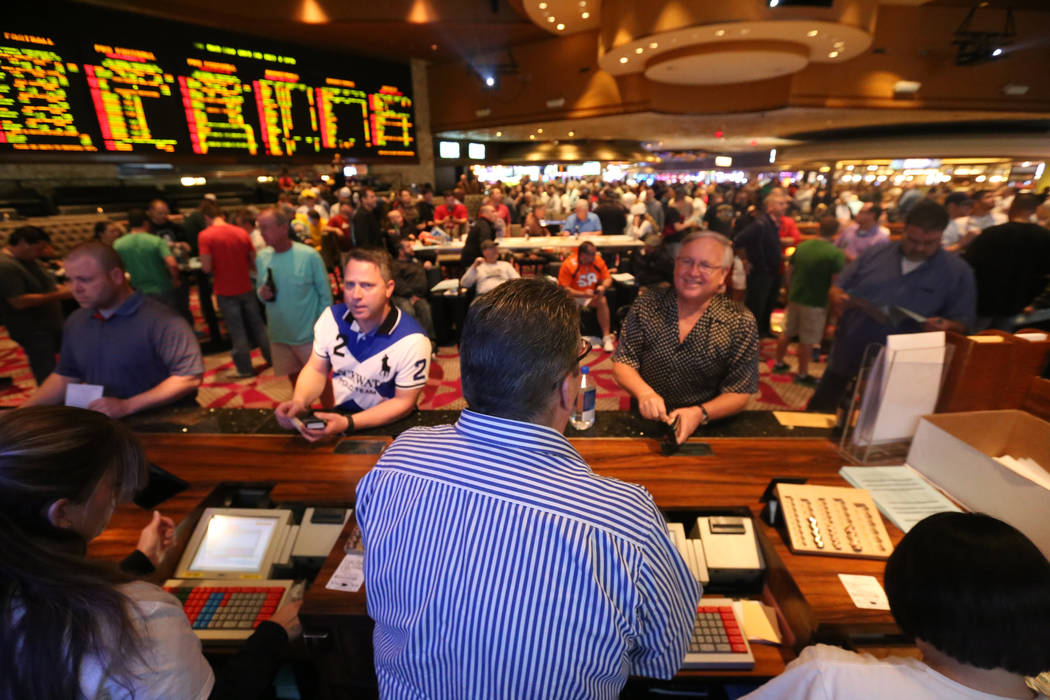 Bookmaker Jay Rood at the Race & Sports Book betting counter at the Mirage casino where crowds place bets for Super Bowl Sunday. Rachel Aston/Las Vegas Review-Journal Follow @rookie__rae