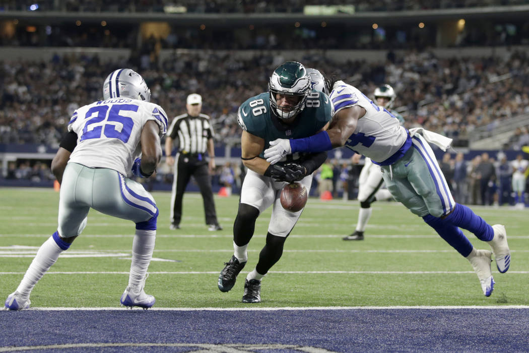 Nov 19, 2017; Arlington, TX, USA; Philadelphia Eagles tight end Zach Ertz (86) fumbles the ball after being hit by Dallas Cowboys linebacker Jaylon Smith (54) in the fourth quarter at AT&T Sta ...