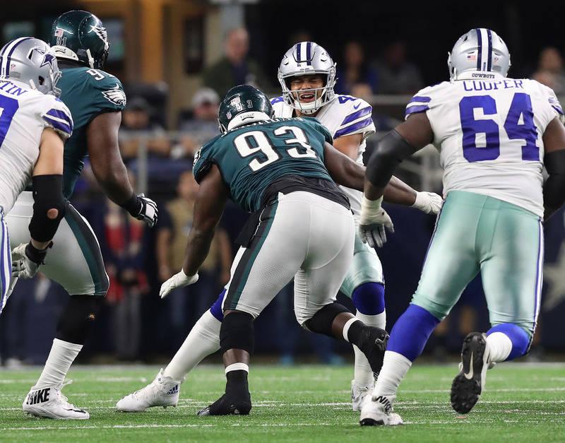 Nov 19, 2017; Arlington, TX, USA; Dallas Cowboys quarterback Dak Prescott (4) is sacked in the fourth quarter by Philadelphia Eagles defensive tackle Tim Jernigan (93) at AT&T Stadium. Mandato ...