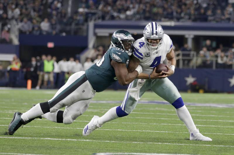 Nov 19, 2017; Arlington, TX, USA; Philadelphia Eagles defensive end Brandon Graham (55) sacks Dallas Cowboys quarterback Dak Prescott (4) in the fourth quarter at AT&T Stadium. Mandatory Credi ...