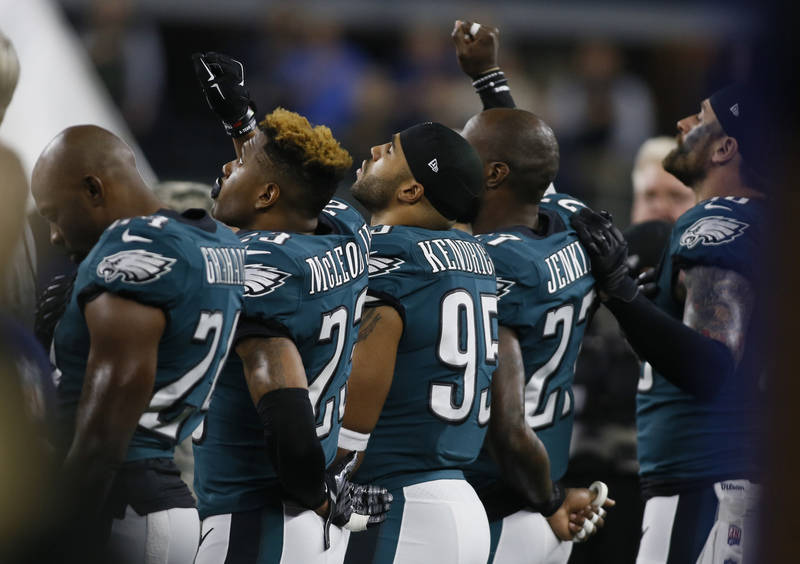 Nov 19, 2017; Arlington, TX, USA; Philadelphia Eagles safety Rodney McLeod (23) and safety Malcolm Jenkins (27) raise their fists doing the national anthem before the game against the Dallas Cowbo ...