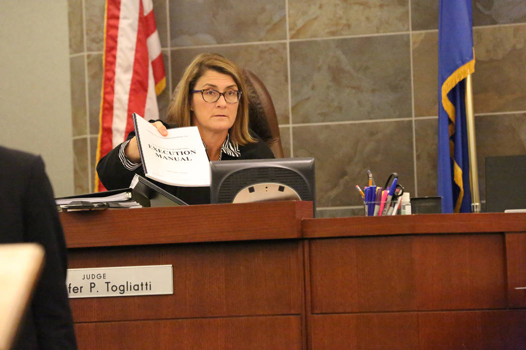 District Judge Jennifer Togliatti holds the execution manual during a hearing for Scott Dozier on Nov. 8, 2017, at the Regional Justice Center in Las Vegas. Michael Quine/Las Vegas Review-Journal  ...