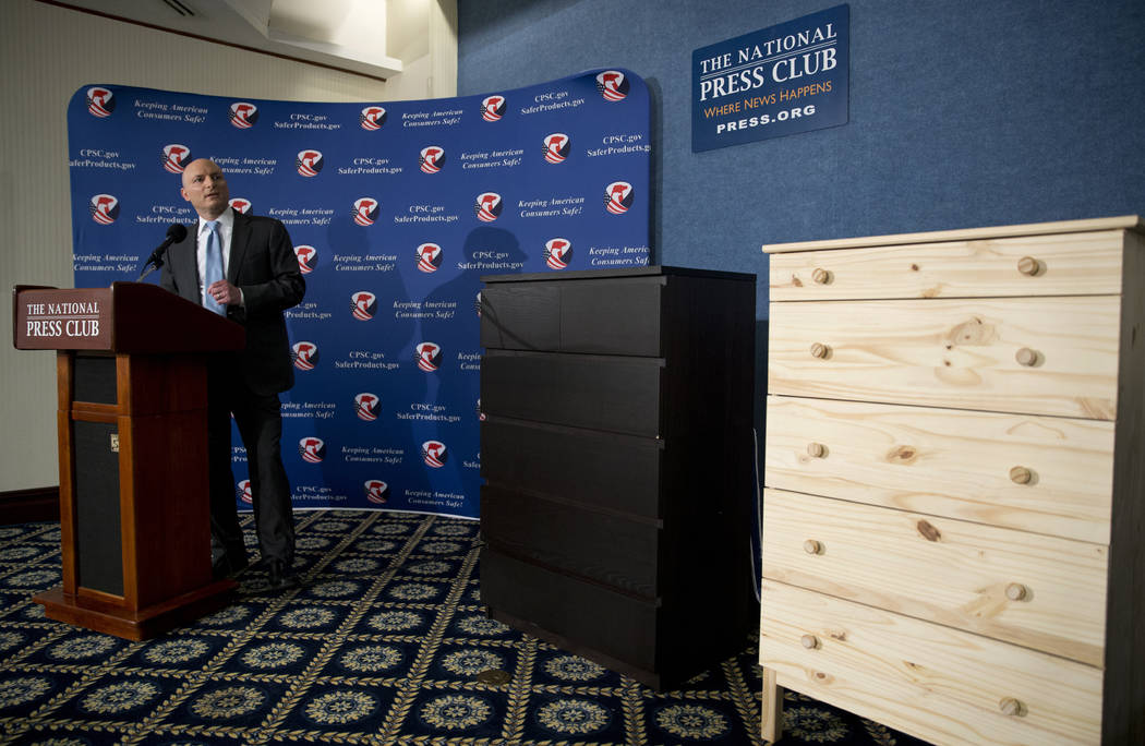 Two Ikea dressers displayed at right, Consumer Product Safety Commission (CPSC) Chairman Elliot Kaye speaks during a news conference at the National Press Club in Washington on Tuesday, June 28, 2 ...