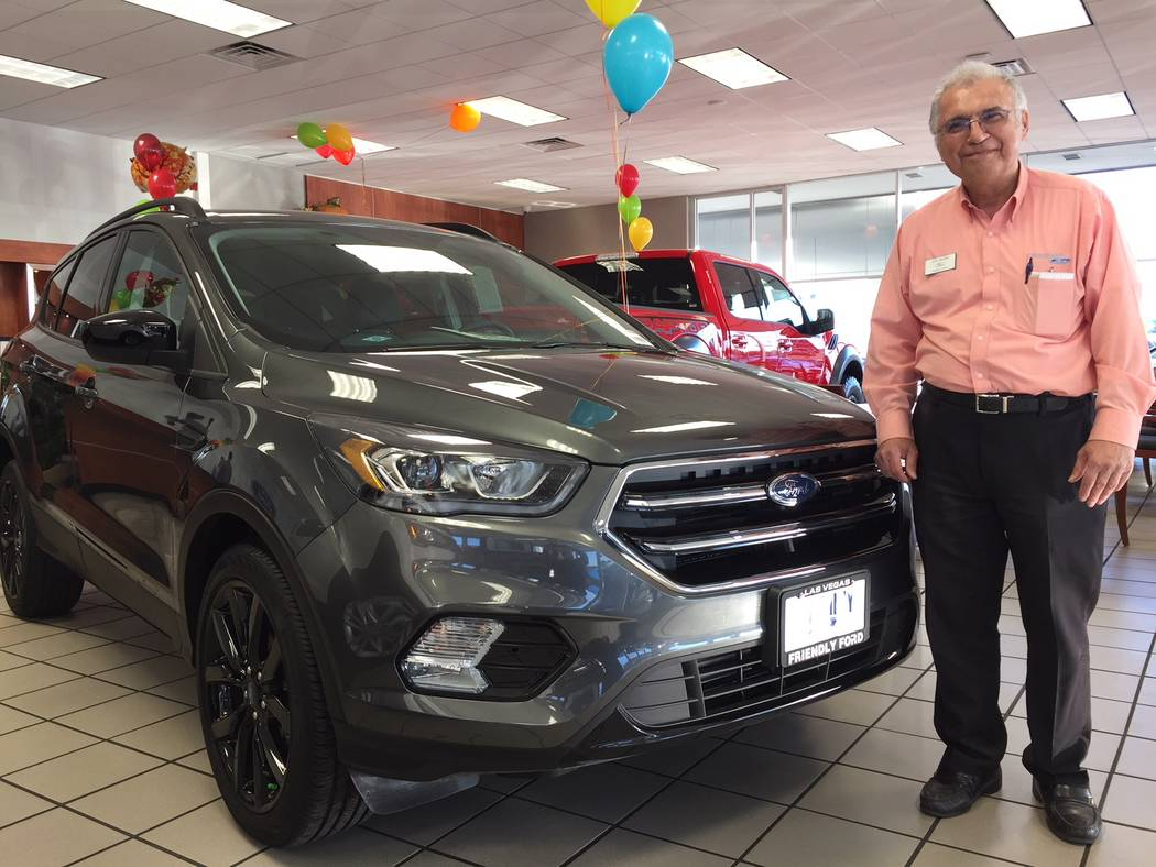 Friendly Ford Friendly Ford sales consultant Joe Nazmi is seen with a 2017 Ford Escape SUV at the dealership located at 660 N. Decatur Blvd.