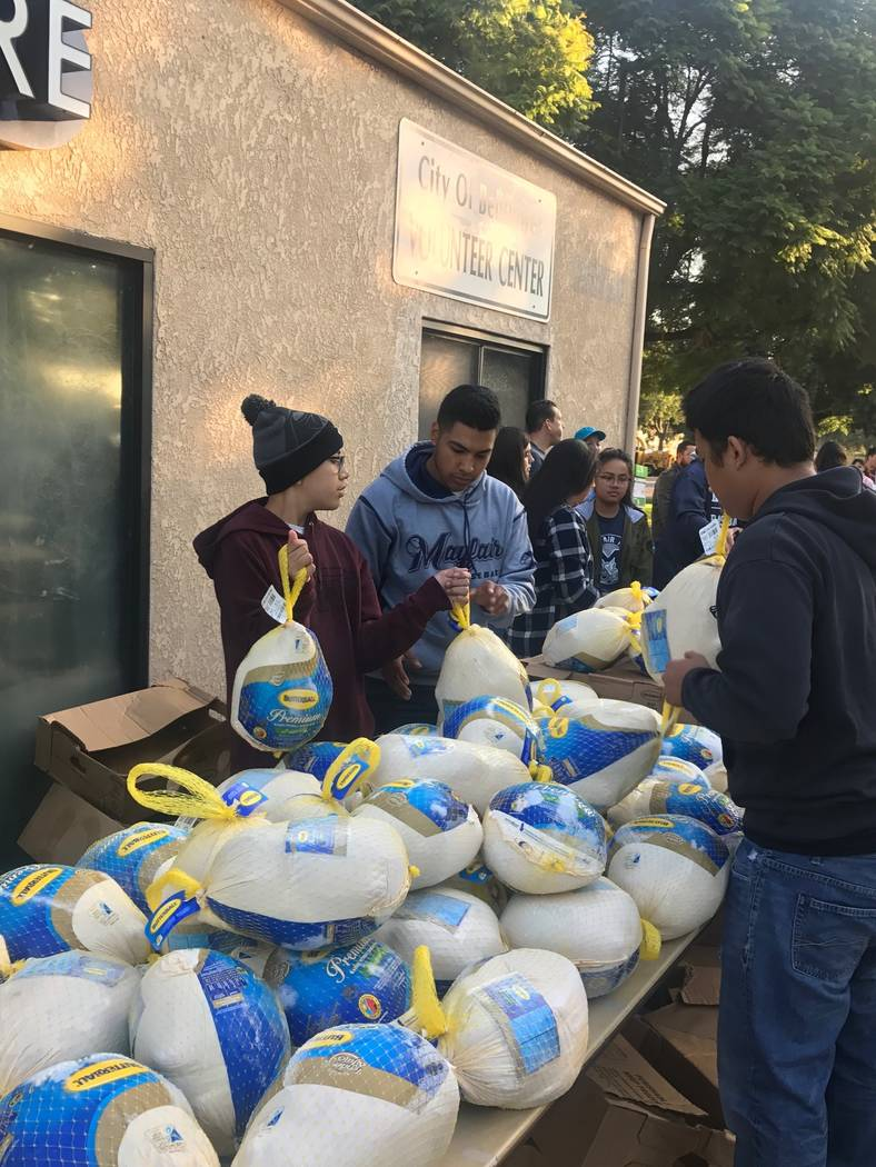 Chris Guillen, 13, and his brother Marcus, 18, collect food for families on Nov. 18, 2017 in Bellflower, Calif. (Jesse Guillen)