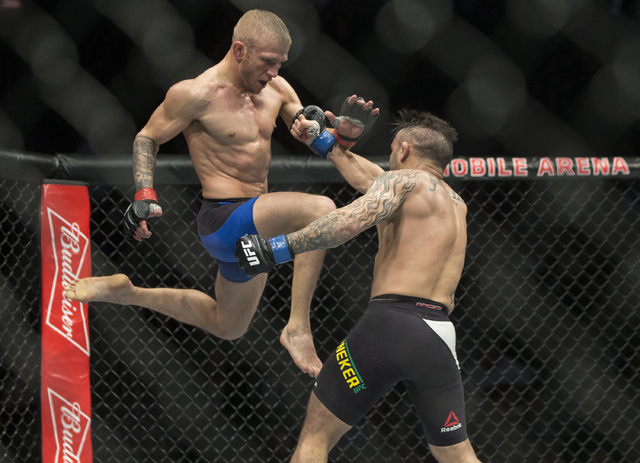 TJ Dillashaw lands a flying knee against John Lineker during their bantamweight fight at UFC 207 at T-Mobile Arena on Friday, Dec. 30, 2016, in Las Vegas. Benjamin Hager/Las Vegas Review-Journal