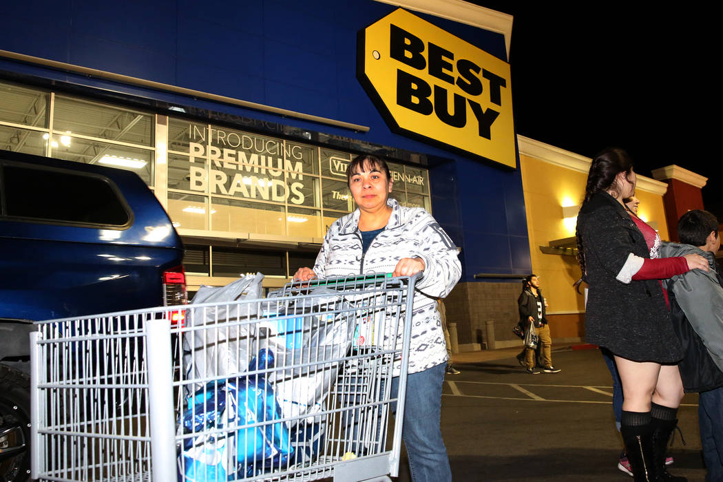 Maria Flores walks out with her purchase after Thanksgiving Day shopping at Best Buy in Henderson Friday, Nov. 24, 2017, in Las Vegas. Bizuayehu Tesfaye Las Vegas Review-Journal @bizutesfaye