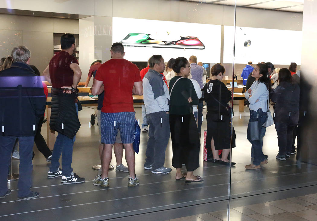 People stand in line inside the Apple Store on the Strip at the Fashion Show Mall on Black Friday, Nov. 24, 2017, in Las Vegas. Bizuayehu Tesfaye Las Vegas Review-Journal @bizutesfaye