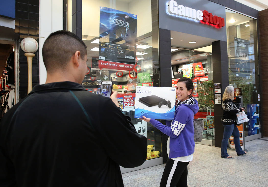 A shopper, who declined to give her name, shows off her new PS4 outside GameStop at the Galleria Mall on Black Friday, Nov. 24, 2017, in Henderson. Bizuayehu Tesfaye Las Vegas Review-Journal @bizu ...