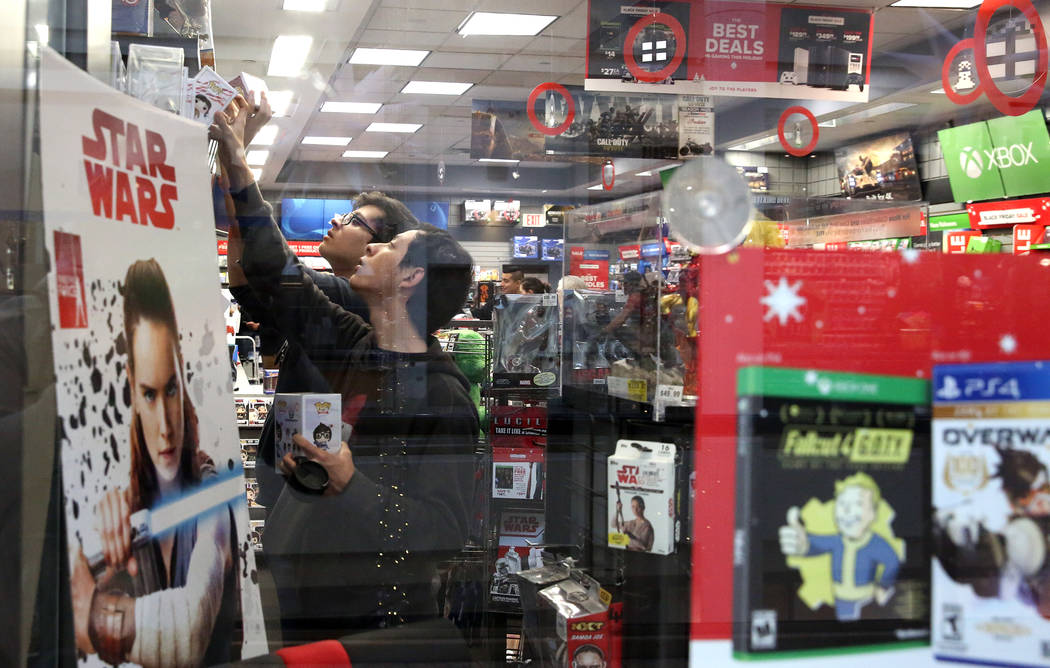 Shoppers, who declined to give their names, shop at GameStop at the Galleria Mall on Black Friday, Nov. 24, 2017, in Henderson. Bizuayehu Tesfaye Las Vegas Review-Journal @bizutesfaye