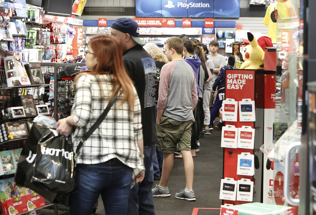 People stand in line inside GameStop at the Galleria Mall on Black Friday, Nov. 24, 2017, in Henderson. Bizuayehu Tesfaye Las Vegas Review-Journal @bizutesfaye