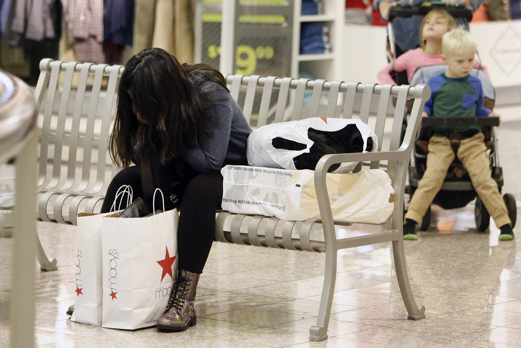 Dulce Solian, 18, of Henderson takes a break outside JCPenny at the Galleria Mall on Black Friday, Nov. 24, 2017, in Henderson. Bizuayehu Tesfaye Las Vegas Review-Journal @bizutesfaye
