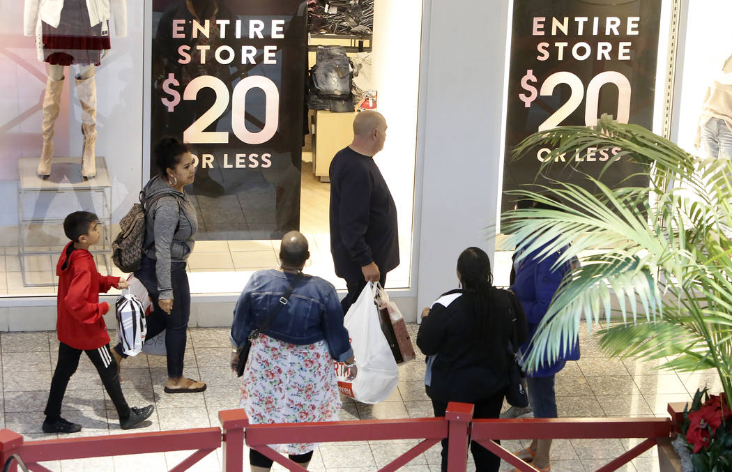 People, including Art Martinez, center, shop at the Galleria Mall on Black Friday, Nov. 24, 2017, in Henderson. Bizuayehu Tesfaye Las Vegas Review-Journal @bizutesfaye