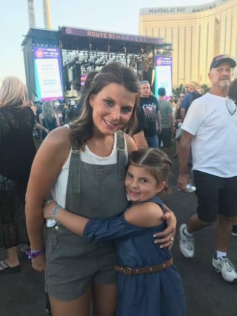 Ali LeRocque, 7, hugs her mom, Rhonda, at the Route 91 Harvest Music Festival. Rhonda died at the Oct. 1 shooting.
