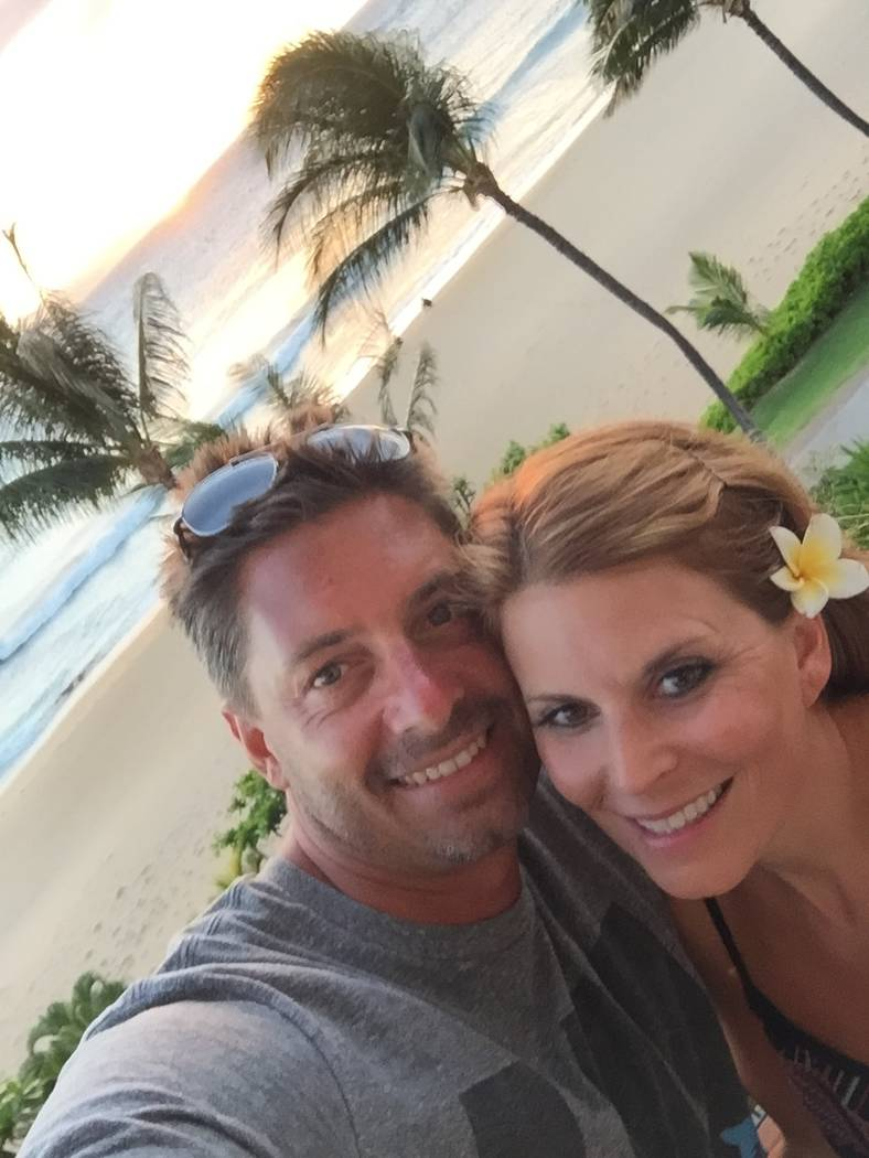 Jason and Rhonda LeRocque take in the surf and sand during a Hawaiian vacation. Rhonda was killed at the Oct. 1 shooting in Las Vegas.