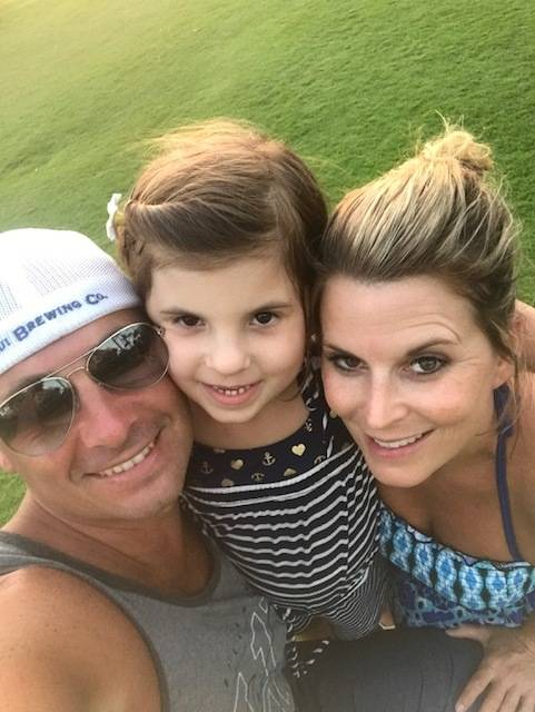 Jason and Rhonda LeRocque cuddle with daughter Ali during a Maui vacation. Rhonda was killed Oct. 1 at the shooting in Las Vegas.