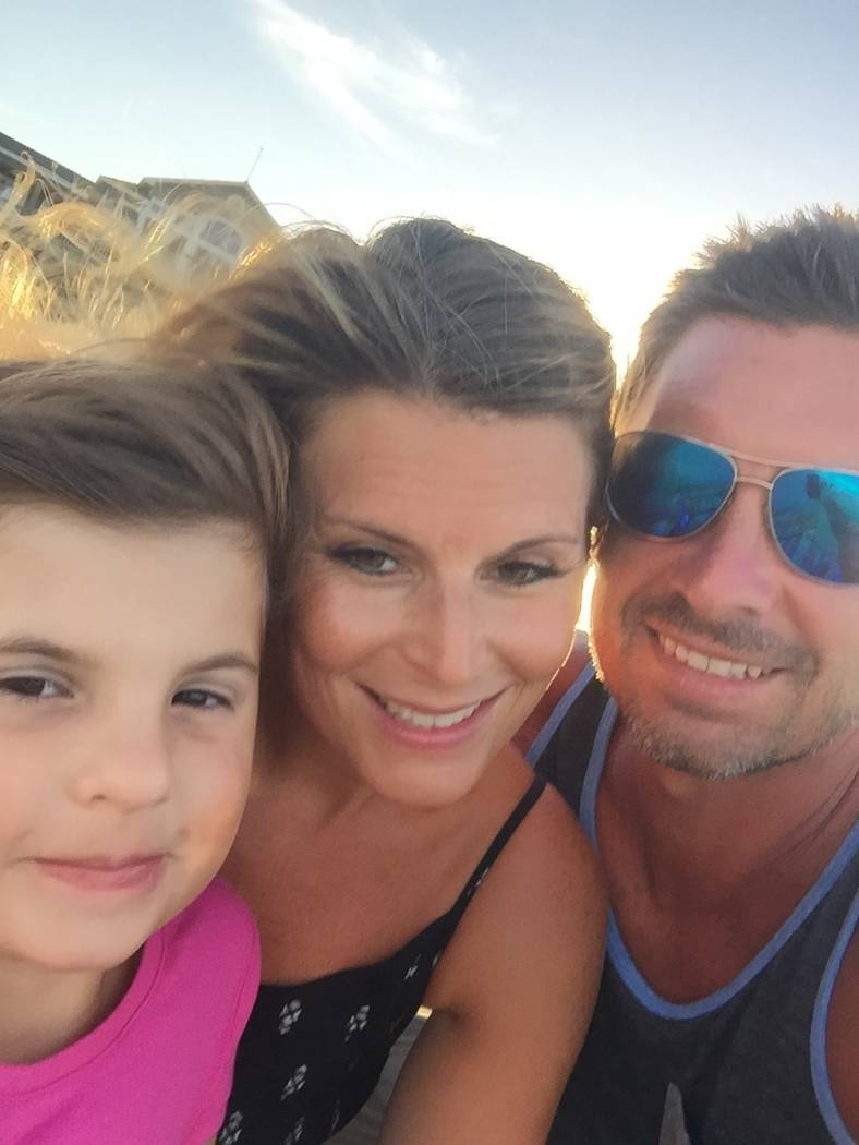 Ali LeRocque, 7, and her mom, Rhonda, and dad, Jason, relax during a trip to the Outer Banks islands in North Carolina. Rhonda was killed Oct. 1 at the shooting at the Route 91 Harvest Music Festival.