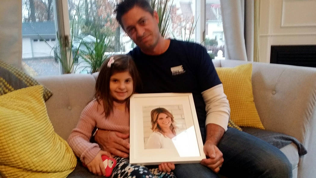 Jason LeRocque and daughter  Ali, 7, hold photo of late wife Rhonda at home in Tewksbury, Mass. on Nov. 16, 2017. Steve Bornfeld Las Vegas Review-Journal